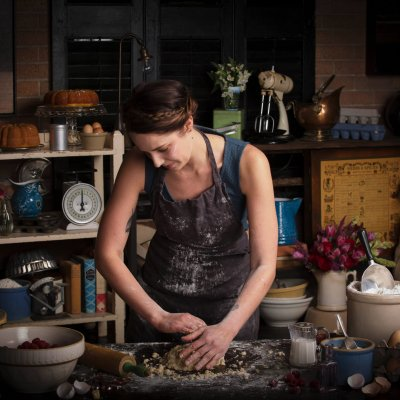 valentines-day-baking-young-woman-standing-in-a-ki-VCZKGGM (1)